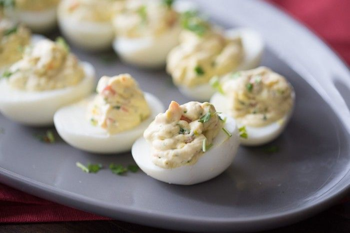 A simple deviled egg recipe with ranch seasoning and fresh garden veggies!