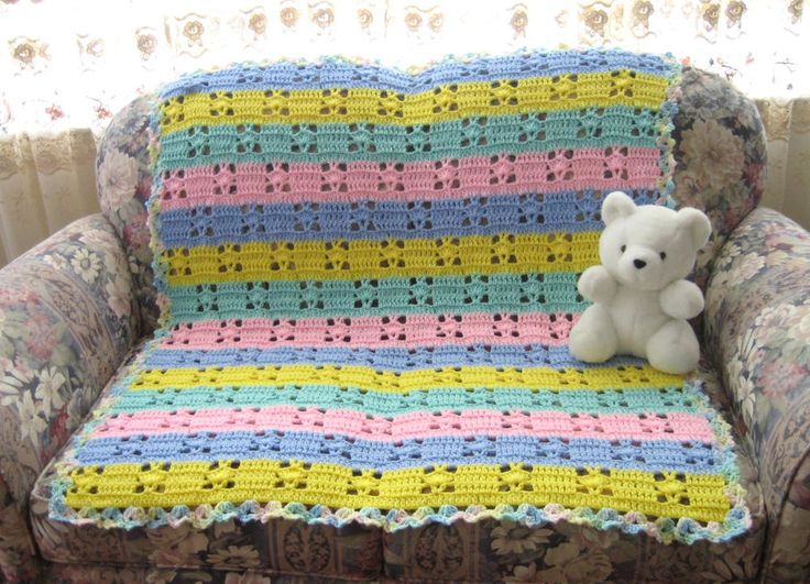 All your little one needs to go to sleep is a lullabye and this Hushabye Baby Blanket Crochet Pattern. You'll fall in love with the pastel colors worked in two different crochet stitches: the v stitch and the shell stitch.