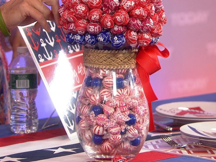 {Lollipop centerpiece! Poke tootsie pops into a styrofoam ball to create a