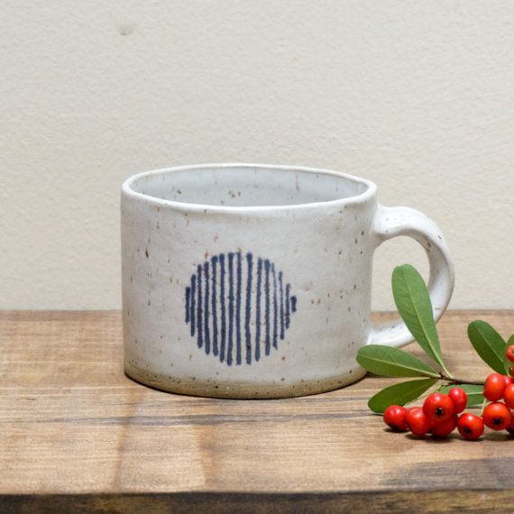 This hand-built stoneware mug is exactly the mug we want to hold our steaming cup of Earl Gray tea. Hand-painted blue striped circles add