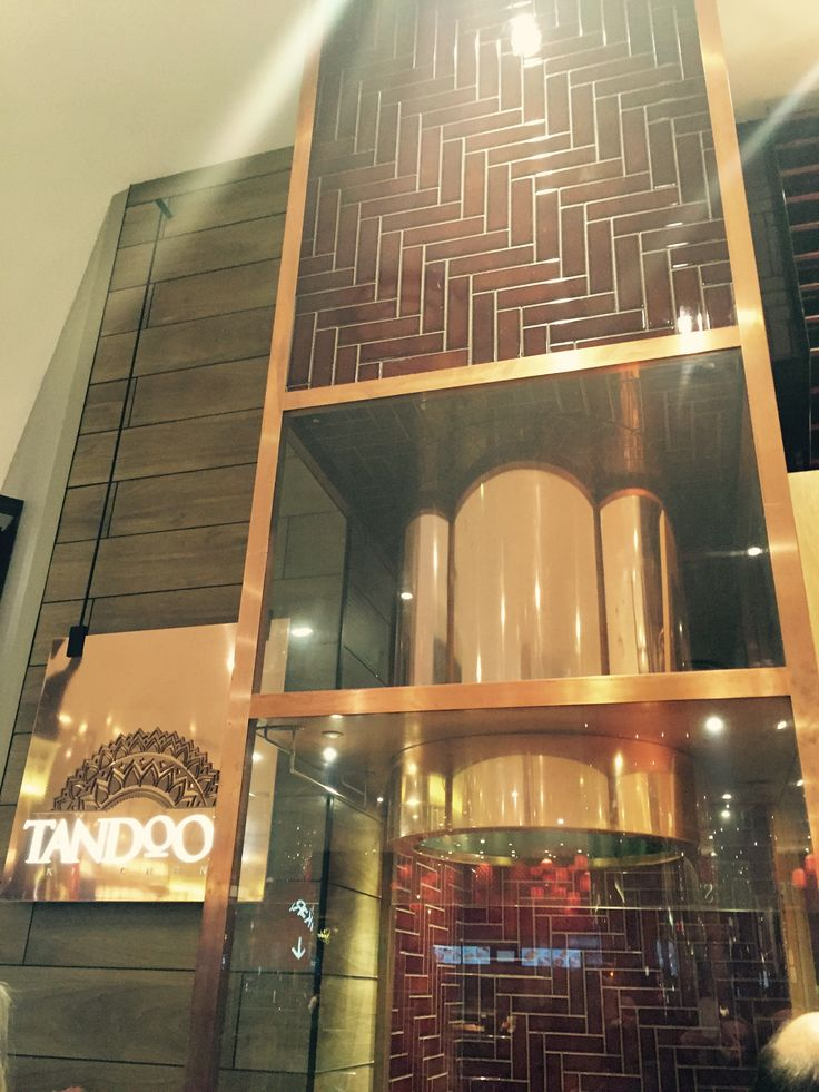 Photo 3: A mix of materials used at this food outlet - copper, tiles & timber