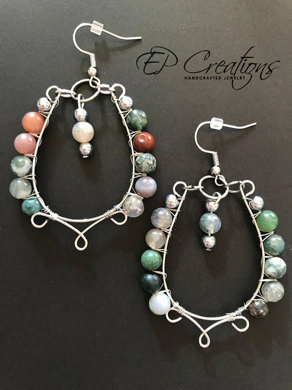 Silver teardrop hoop earrings with multi-color stone beads. Beautiful, unique silver teardrop hoop earrings with multi-color stone beads. Beads on picture mostly green and brown. Cannot guarantee bead color for shipped product. Earrings are designed for special occasions as well as