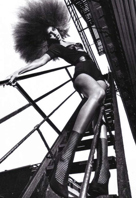 Liya Kebede  Photo: Mario Sorrenti | fashion editorial | afro | legs | posing | bridge | ladder | stairs