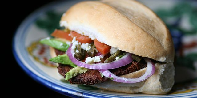 Tortas de Milanesa (Beef Cutlet Sandwich) - Sometimes a sandwich can be viewed as a second class lunch, but this is never the case with a good Torta de Milanesa. The perfectly balanced flavors of crispy fried beef layered with avocado, tomato, onion and sour spicy jalapeños is what food dreams are made of.