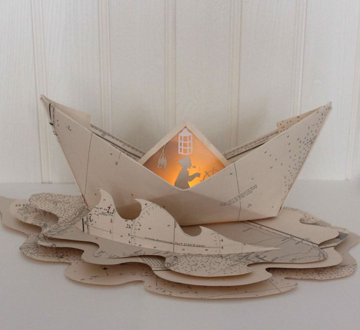 Kate shows how to make a paper boat luminary