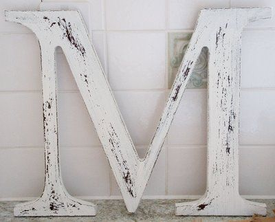 distressing with wax and paint- this would look great on my mantle...in the letter S of course and a different color than white