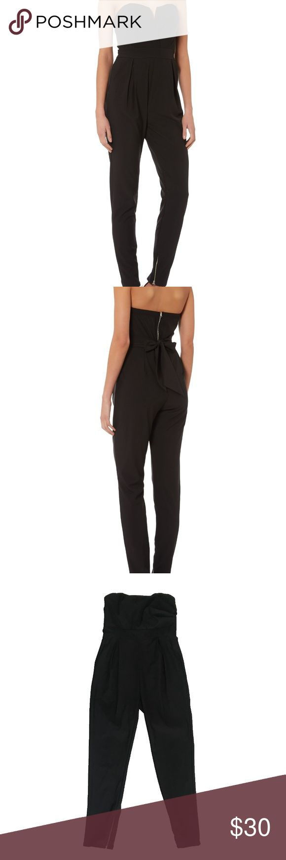 "TFNC London Black Strapless Jumpsuit TFNC London black strapless jumpsuit with zipper leg openings at bottom  Previously owned, like new  Flat Measurements Bust: 15 1/2"" Waist: 14 1/2"" Rise: 12"" Inseam: 29"" Length top to waist: 9"" Length waist to leg opening: 40 1/2"" Leg opening: 6""  FFS291 TFNC Pants Jumpsuits & Rompers"
