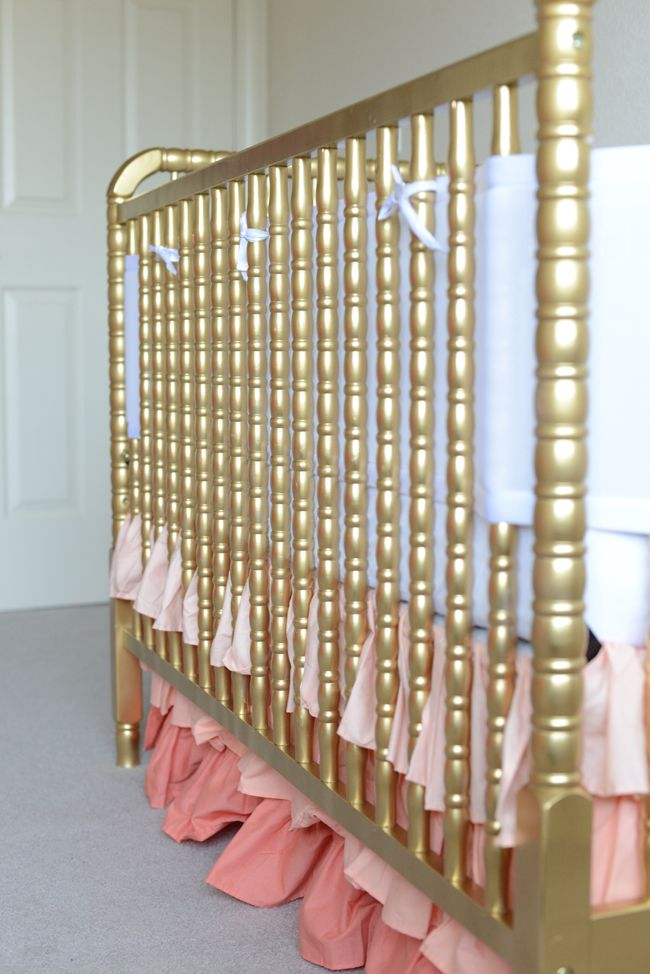 Love the gold crib and and coral ruffles! <3