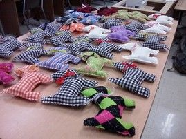 Mehlville High School   Sewing for Santa   Students in the Fundamentals of Sewing class used donated fabric to make stuffed Scottie dogs. These items were used to fulfill a requirement for the Shoebox Project, a project sponsored anually by Mehlville's National Honor Society (MNHS) which collects items for children. MNHS places the items in shoeboxes and wraps them to give to students at a school in need. This year, the Shoebox Project collected a record number of boxes and contributed 55…