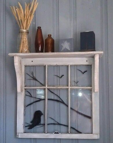 Old Window handpainted with a shelf of reclaimed materials.
