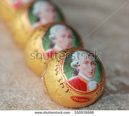 Kragujevac January 07, 2017. Mozart ball in the row, macro close up view. Mozart ball is small round sugar confection made of pistachio marzipan, and nougat, covered with dark chocolate.