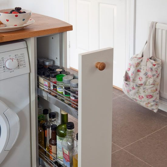 Small kitchen with neutral floor tiles, white cabinetry, slim larder and wood worktops