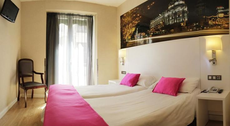 Hostal Olmedo Madrid Olmedo has an ideal location in the heart of Madrid, just 100 metres from the Puerta del Sol. This guest house offers good-value, modern accommodation in a 19th-century building.  Rooms at the Hostal Olmedo are simple and stylish.