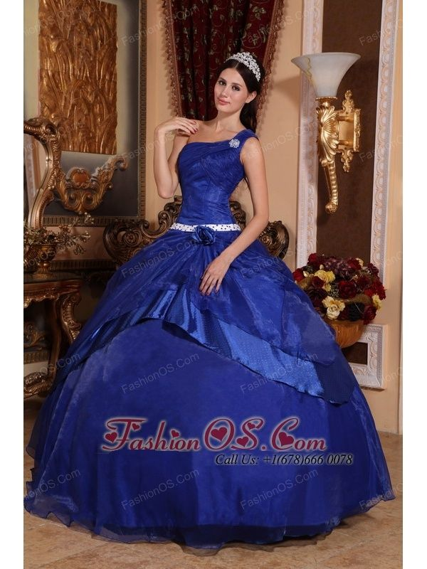 Top Seller Royal Blue Quinceanera Dress One Shoulder Organza Beading Ball Gown  http://www.fashionos.com  The notable quinceanera dress creates a touching effect which makes you the hotline. What makes the dress special is the one-shoulder strap accented with a shimmering broach and dotted fabric on waist and overlay. Ruching bust and handmade flower add interest and detail to the dress. The skirt is full and shapely, thanks to many layers of organza and satin.