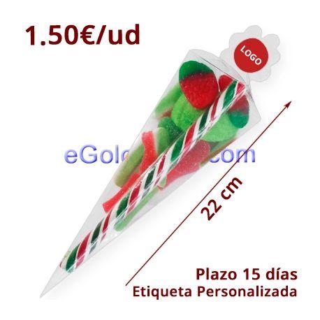 Cono Chuches Navidad 90gr Personalizado son 50 cajas cono acetato transparente con 90 gramos de Chuches Navidad que incluye un Bastón de Caramelo con polvo pica y un surtido de chuches de color verde y rojo. Etiqueta personalizada.(NO INCLUYE el diseño de la etiqueta)