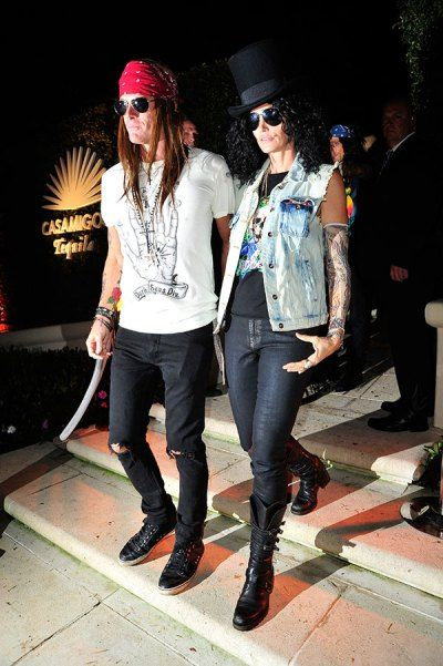 Cindy Crawford and Rande Gerber basically just won the most fun couple award. Here they are as Slash and Axl Rose.