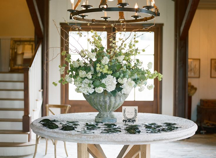 Escort Card Table with Flowers in Urn | photography by http://www.sarahjanewinter.com/