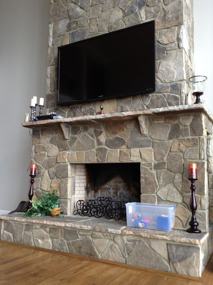 Small Stone Fireplace With 80 Inch Tv