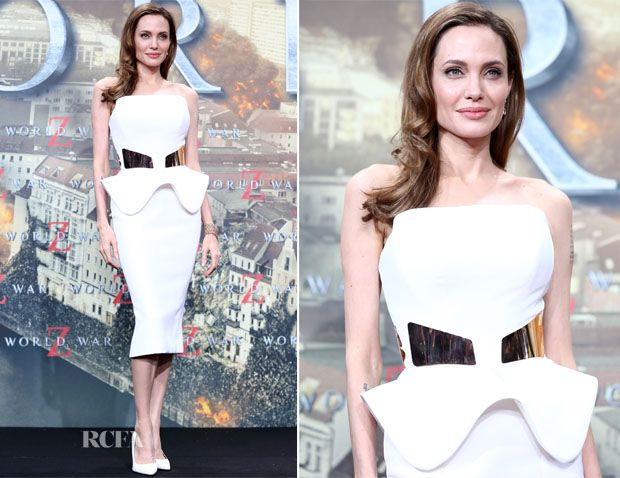 Angelina Jolie supported her hubby Brad Pitt at his movie premiere of World War Z in Germany. She donned a peplum white dress with gold detailing from Ralph  Russo.