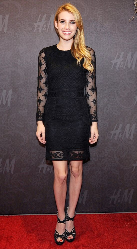 Emma Robers celebrated the H&M store opening in New Orleans in a black shift dress with sheer details and black strappy sandals.