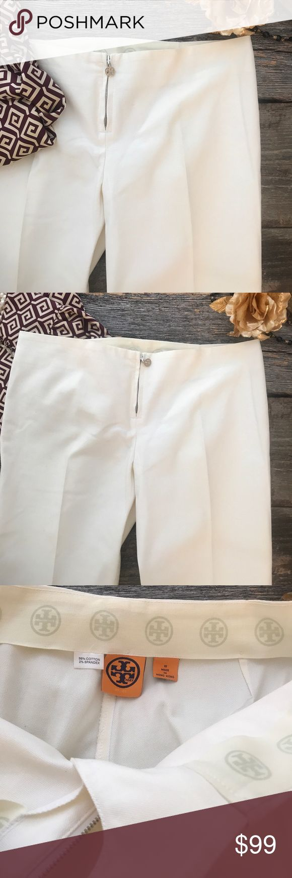 || Tory Burch || White Cotton Dress Trousers These creamy white cotton pant (98% cotton with 2% spandex) complete your outfit with the silk tunic (shown in picture and listed separately). Mid-century modern flair with a low on the hip with a zipper at waist. Silver Tory logo toggle. Great detailing at the back knee. Note to buyer: white pants get dirty and these have a few grey spots. I have reduced the price to support these very minor spots. Inseam is 33 inches. Waist is 34.5 inches. Tory…