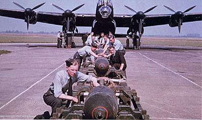 Armourers preparing bombs for loading aboard a Lancaster Bomber