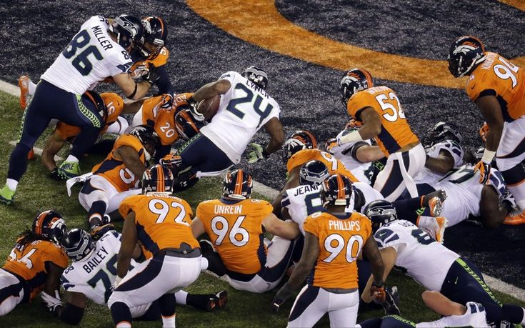 Beast mode: Marshawn Lynch gets through the Denver Broncos defence to score Seattle's first touchdown