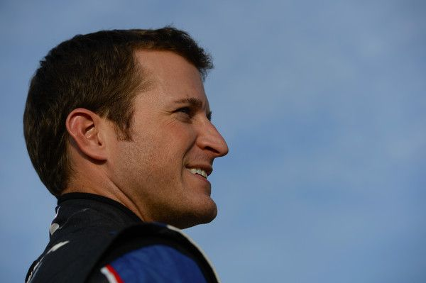 Kasey Kahne Photos Photos - Kasey Kahne, driver of the #5 Farmers Insurance Chevrolet, looks on during qualifying for the NASCAR Sprint Cup Series Federated Auto Parts 400 at Richmond International Raceway on September 9, 2016 in Richmond, Virginia. - Richmond International Raceway - Day 1