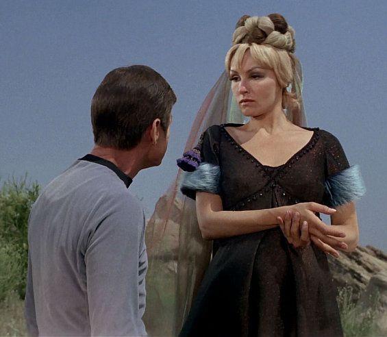 Julie Newmar star trek | Julie Newmar in Star Trek looking down at Dr McCoy