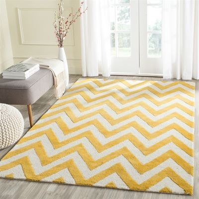 Place a yellow chevron rug in a space that needs a little funk and has a lot of bright light. The combination of yellow and white especially creates a happy, upbeat mood. Grab a book and read in your space. Safavieh Rug. #yellowrug #yellowdecor #brightroom #happydecor