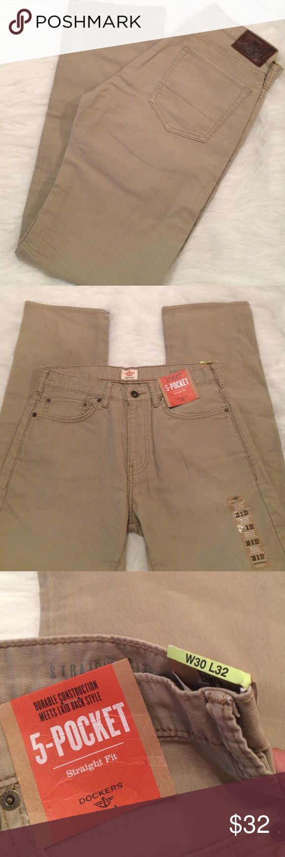 NWT Men's Docker Khaki Pants NWT pair of men's khaki Docker pants. They are size 30x32, 5 pocket, straight fit. They don't feel like jeans but they don't feel like the normal khaki pants either. I would say more of a casual khaki pant. Please ask any and all questions before purchasing. Happy Poshing💕💕💕 Dockers Pants Straight Leg
