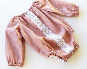 Pink baby romper with lace detail and snaps for easy nappy changes