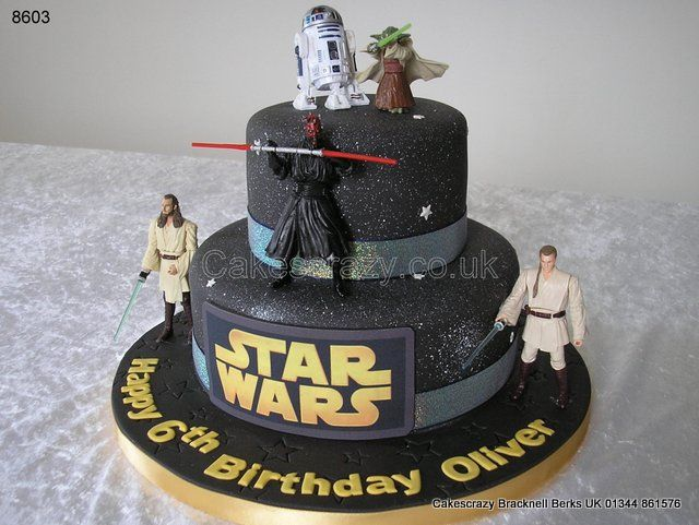 Themed Star Wars birthday cake decorated in a black galactic finish with gold logo. Selection of StarWars characters strategically placed on and around the cake. Characters are supplied by the client http://www.cakescrazy.co.uk/details/starwars-cake-8603.html