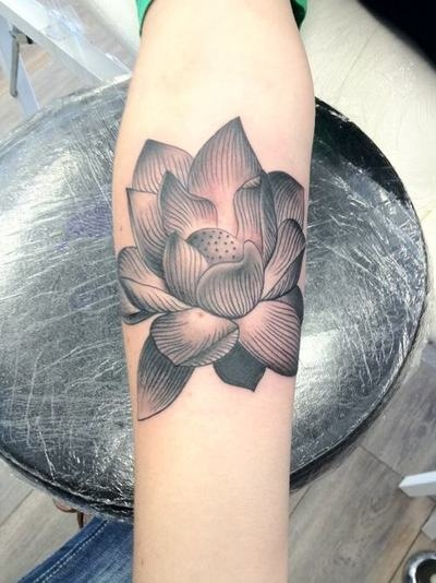 17 best images about tattoo on pinterest circles buddha for Flower tattoos on lower arm