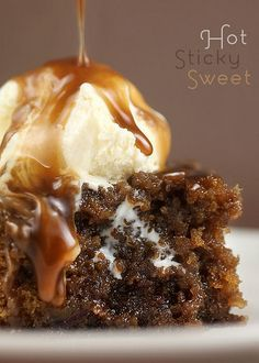 Sticky Toffee Pudding: a warm, soft, sweet cake soaked in toffee sauce served with vanilla ice cream