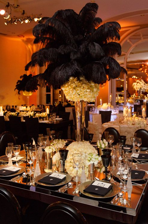 Exuding classic elegance, black feathers top a topiary of fresh blooms for an extravagant wedding centerpiece. (Beverly Hills Hotel)