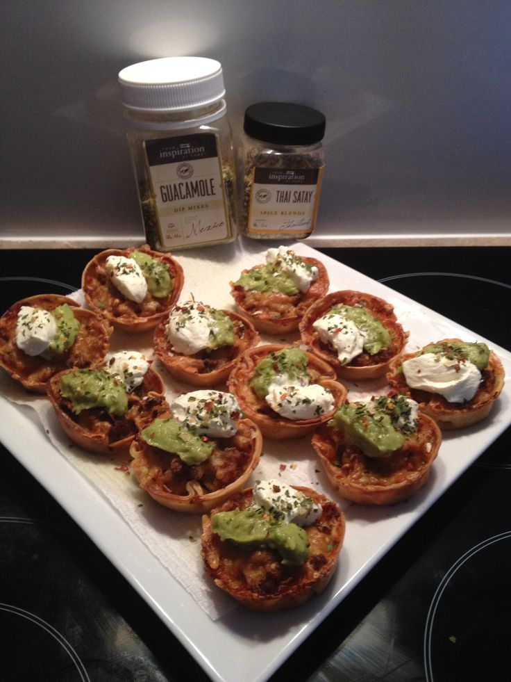 Thai satay Chicken San Choy Bau in crispy gow gee wrappers with YIAH Guacamole toppings