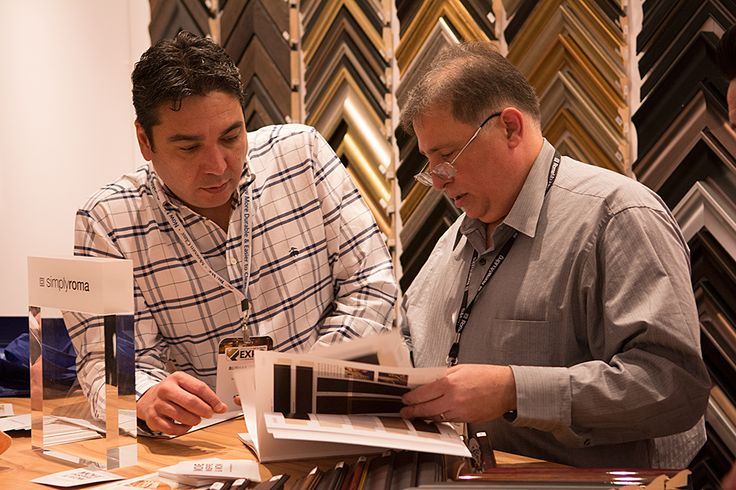 Anthony going through our catalogue with a partner at #WCAF15 #ChoosePowerfully