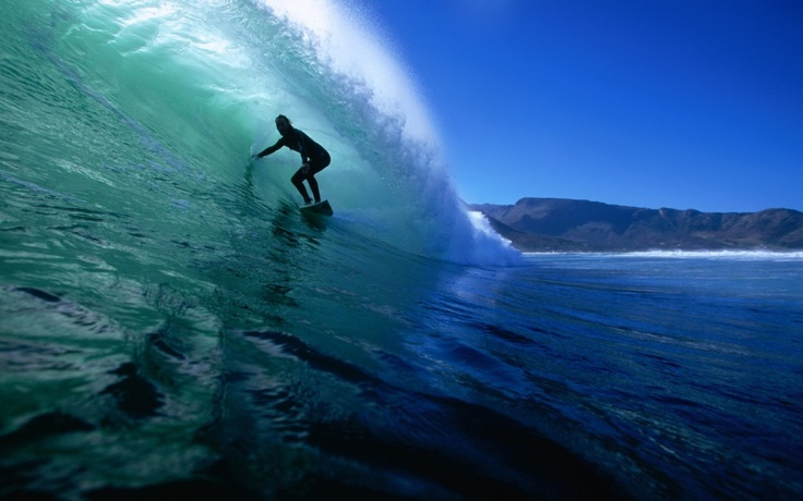 Surfing at Noordhoek Beach, Cape Town, South Africa.