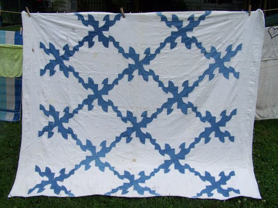 Blue and white antique quilt; possibly a cutter quilt; Drunkard's Path design