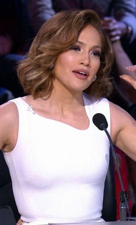 Who made  Jennifer Lopez's white dress?