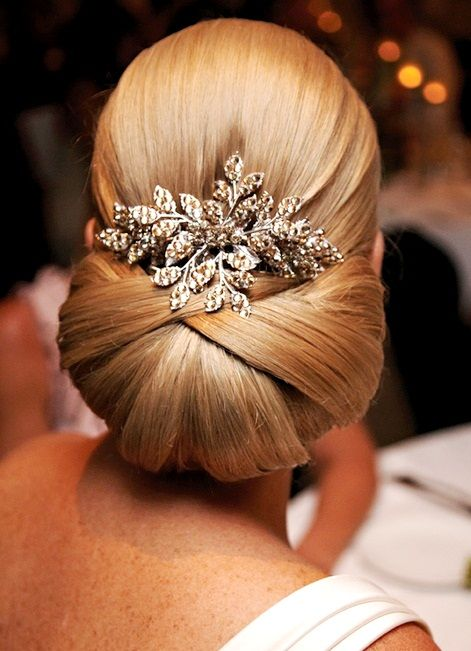 Bride's sleek classic French chignon bridal hair ideas