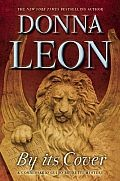 By Its Cover by Donna Leon: In the pages of Donna Leon's internationally bestselling Commissario Guido Brunetti mysteries, the conversations of the Brunetti family have often turned to topics of art and literature, but books are at the heart of this novel in a way they never have been before. One...