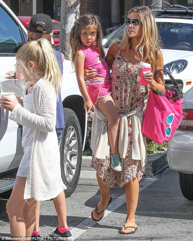 Coffee date! Denise Richards had a cup of Joe in hand as she carried her youngest Eloise J...