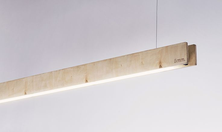 Simple, linear lampHa. It is available in three different types - oak, plywood or powder coated aluminium.