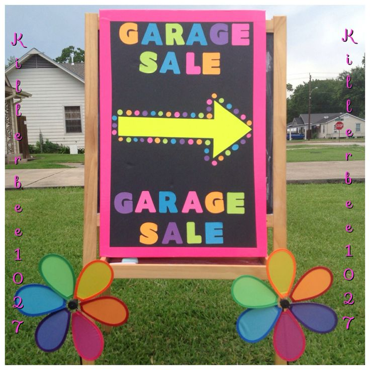 GARAGE SALE SIGN - Double Sided Sign  ~ Easel (Free from neighbor) ~ Two black boards (Dollar Tree) ~ Spinning yard flowers (Dollar Tree) ~ Neon pink duct tape for border (Walmart) ~ Neon sticky letter (Walmart)    I used 4 spinning yard flowers (2 on each side) to grab peoples attention and it sure did work.  I also poked holes on the corner of the boards to have them hold on to each other.