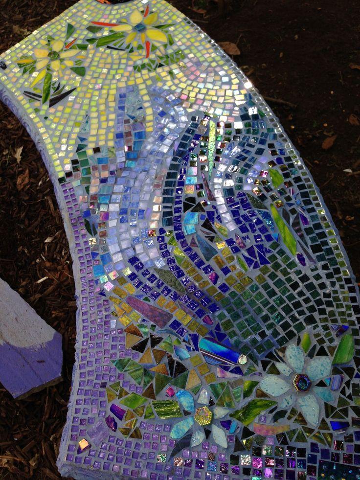 Sun/moon mosaicked concrete garden bench using scrap glass and broken fused tiles.