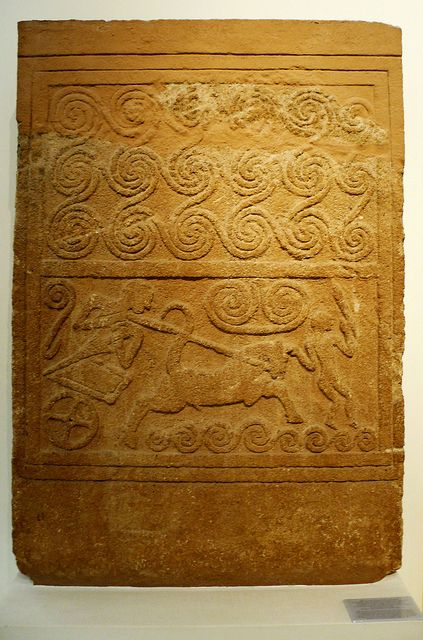1500 BCE. Mycenaean Funerary stone stele with chariot scene with spriral motifs. Mycenae, Grave Circle A, Grave V.  National Archaeological Museum, Athens.