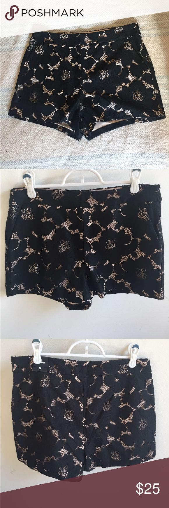 Express black lace over nude shorts Bought these from Express but they are a little too big. So cute though, with a floral lace pattern over a beige-colored lining. Mid-rise and measure about 13.5 inches from top of waist to hem. Hidden side zipper. Express Shorts