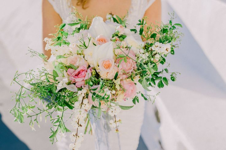 Breathtaking Light + Love In Santorini! Read More: https://www.stylemepretty.com/2018/03/08/romantic-intimate-destination-wedding-santorini/  Romantic wedding in Santorini Intimate wedding Santorini